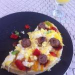 Scrambled egg and waffle breakfast pizza