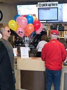 Old crowding the McDonald's counter