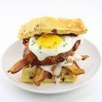 The Hickory Smoked Brown Sugar Boneless Pork Chop Waffle Breakfast Sandwich
